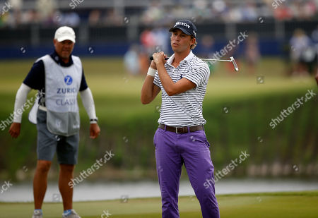 Smylie Kaufman reacts to missing a putt on the 18th green during the second round of the PGA Zurich Classic golf tournament's new two-man team format at TPC Louisiana in Avondale, La