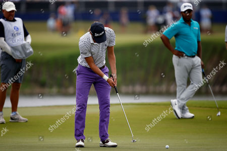 Smylie Kaufman putts on the 18th green during the second round of the PGA Zurich Classic golf tournament's new two-man team format at TPC Louisiana in Avondale, La
