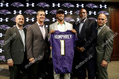 Marlon Humphrey, Ozzie Newsome, John Harbaugh, Eric DeCosta, Joe Hortiz Cornerback Marlon Humphrey, center, the Baltimore Ravens' first-round draft pick, poses before a news conference at the NFL football team's practice facility in Owings Mills, Md., . With Humphrey are director of college scouting Joe Hortiz, coach John Harbaugh, general manager Ozzie Newsome and assistant general manager Eric DeCosta, from left