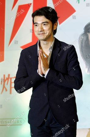 """Japanese actor Takeshi Kaneshiro poses for press during a media event promoting his new movie """"This Is Not What I Excepted"""" in Taipei, Taiwan"""