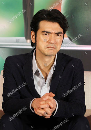 """Japanese actor Takeshi Kaneshiro answers to press during a media event promoting his new movie """"This Is Not What I Excepted"""" in Taipei, Taiwan"""