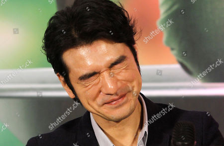 """Stock Image of Japanese actor Takeshi Kaneshiro answers to press during a media event promoting his new movie """"This Is Not What I Excepted"""" in Taipei, Taiwan"""