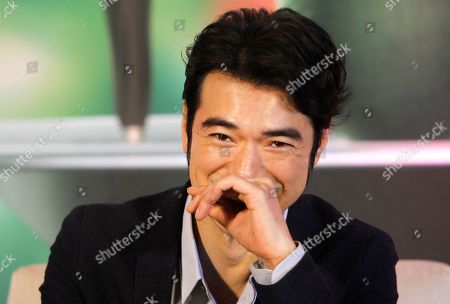 """Stock Photo of Japanese actor Takeshi Kaneshiro answers to press during a media event promoting his new movie """"This Is Not What I Excepted"""" in Taipei, Taiwan"""