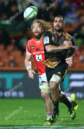 Liam Messam of the Chiefs chased by Willie Britz of the Sunwolves during the Round 10 Super Rugby match between the Chiefs and the Sunwolves at Waikato Stadium in Hamilton, New Zealand, Saturday, April 29, 2017.