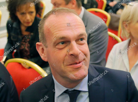 Far-right National Front party's interim leader Steeve Briois smiles as he attend a media conference in Paris, France, . Far-right candidate Marine Le Pen says her new campaign ally, Nicolas Dupont-Aignan, would be her prime minister if she is elected