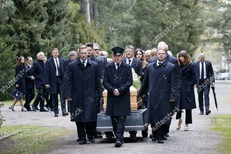 Stock Photo of Cemetery staff carry the coffin of German cinematographer Michael Ballhaus to the grave at the Grunewald cemetery in Berlin, Germany, 29 April 2017. Ballhaus died at the age of 81 on 12 April 2017.