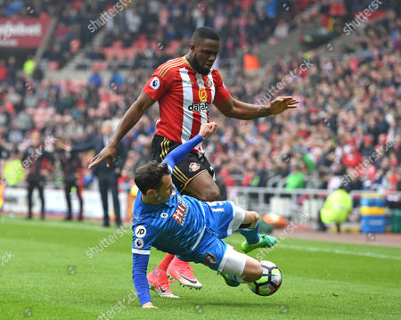Adam Smith of AFC Bournemouth (right) tackles Victor Anichebe of Sunderland during the Premier League match between Sunderland and AFC Bournemouth played at Stadium of Light, Sunderland on 29th April 2017