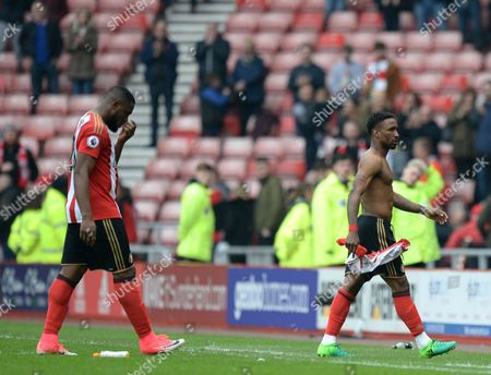 Jermain Defoe of Sunderland (right) and Victor Anichebe of Sunderland walk off dejected after being relegated from the Premier League during the Premier League match between Sunderland and AFC Bournemouth played at Stadium of Light, Sunderland on 29th April 2017
