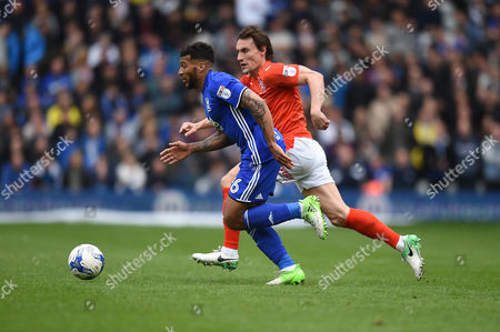David Davis of Birmingham City is chased down by Dean Whitehead of Huddersfield Town during the Sky Bet Championship match between Birmingham City v Huddersfield Town played at St Andrew's Stadium, Birmingham on 29th April 2017
