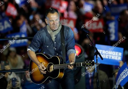 """Bruce Springsteen performs during a Hillary Clinton campaign event at Independence Mall in Philadelphia. Springsteen and Tom Hanks paid tribute to the late director Jonathan Demme, the man who brought them together on his film """"Philadelphia,"""" which won each of them Oscars"""