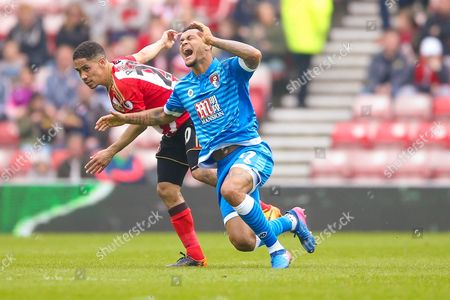 Bournemouth Forward Joshua King (17) is fouled by Sunderland midfielder Steven Pienaar (20)  during the Premier League match between Sunderland and Bournemouth at the Stadium Of Light, Sunderland