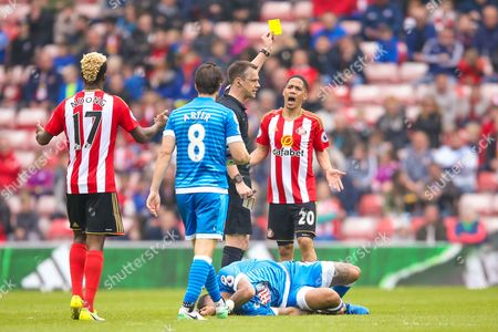 Stock Photo of Sunderland midfielder Steven Pienaar (20) is booked and receives a caution and a yellow card from todays referee Stuart Attwell for his foul on Bournemouth Forward Joshua King (17) during the Premier League match between Sunderland and Bournemouth at the Stadium Of Light, Sunderland