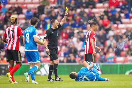 Sunderland midfielder Steven Pienaar (20) is booked and receives a caution and a yellow card from todays referee Stuart Attwell for his foul on Bournemouth Forward Joshua King (17) during the Premier League match between Sunderland and Bournemouth at the Stadium Of Light, Sunderland