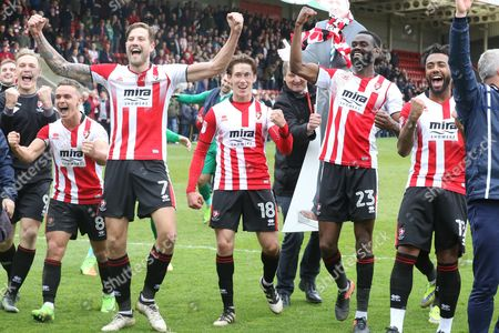 Billy Waters, Harry Pell, James Rowe, Emmanuel Onarise and Jordan Cranston celebrate survival  during the EFL Sky Bet League 2 match between Cheltenham Town and Hartlepool United at Whaddon Road, Cheltenham
