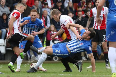Danny Wright and Scott Harrison during the EFL Sky Bet League 2 match between Cheltenham Town and Hartlepool United at Whaddon Road, Cheltenham