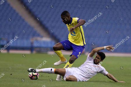 Al-Nassr player Omar Hawsawi (L) in action for the ball with Al-Shabab player Hattan Bahebri (R) during the Saudi Professional League soccer match between Al-Nassr and Al-Shabab at King Fahd International Stadium in Riyadh, Saudi Arabia, 29 April 2017.