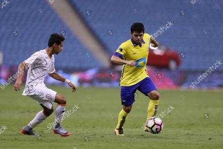 Al-Shabab player Hasan Al-Qaid (L) in action for the ball with Al-Nassr player Yahya Al-Shehri (R) during the Saudi Professional League soccer match between Al-Nassr and Al-Shabab at King Fahd International Stadium in Riyadh, Saudi Arabia, 29 April 2017.
