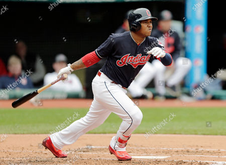 Cleveland Indians' Jose Ramirez watches his two-run double off Seattle Mariners starting pitcher Yovani Gallardo in the first inning of a baseball game, in Cleveland. Carlos Santana and Francisco Lindor scored on the play