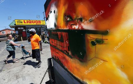 A mural by an artist known as Nery is seen in front of Tom's Liquor at the corner of Florence and Normandie, the flash point of the riots that erupted after the 1992 acquittal of four white police officers in the beating of black motorist Rodney King, on the 25th anniversary, in Los Angeles