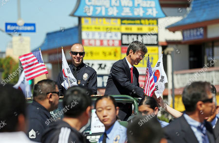 Los Angeles Police Capt. David Kowalski and Korea consul general Key Cheoll Lee lead a peace parade in Los Angeles' Koreatown, sponsored by the Korean-American community with participation by many ethnic groups, on the 25th anniversary of riots that erupted after the 1992 acquittal of four white police officers in the beating of black motorist Rodney King, . Hundreds of Korean-owned businesses were looted, damaged or destroyed in the violence