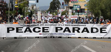 People take part in a rally and peace parade in Los Angeles' Koreatown, sponsored by the Korean-American community with participation by many ethnic groups, on the 25th anniversary of riots that erupted after the 1992 acquittal of four white police officers in the beating of black motorist Rodney King, . Hundreds of Korean-owned businesses were looted, damaged or destroyed in the violence