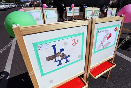 A children's art exhibit is displayed at a rally and peace parade in Los Angeles' Koreatown, sponsored by the Korean-American community with participation by many ethnic groups, on the 25th anniversary of riots that erupted after the 1992 acquittal of four white police officers in the beating of black motorist Rodney King, . Hundreds of Korean-owned businesses were looted, damaged or destroyed in the violence