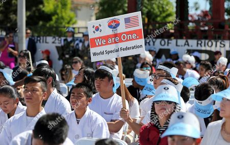 People take part in a rally and peace parade in Los Angeles' Koreatown, sponsored by the World Special Federation with participation by many ethnic groups, on the 25th anniversary of riots that erupted after the 1992 acquittal of four white police officers in the beating of black motorist Rodney King