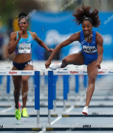 Kendra Harrison, right, clears the final hurdle ahead of Kristi Castlin, left, while winning the women's special 100-meter hurdles at the Drake Relays athletics meet, in Des Moines, Iowa