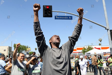 Marcher Edward Johnson chants with other community activists as they gather to commemorate the 25th anniversary of widespread rioting at Florence and Normandie Avenues in South Los Angeles, California, USA, 29 April 2017. This intersection was the flashpoint after the acquittal of LAPD police officers shown in a videotaped beating of black motorist Rodney King. Numerous korean-owned businesses were looted and destroyed in the rioting.