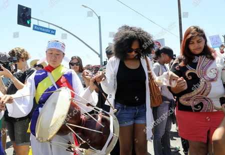 Korean, latino and african-american community activists gather to commemorate the 25th anniversary of widespread rioting at Florence and Normandie Avenues in South Los Angeles, California, USA, 29 April 2017. This intersection was the flashpoint after the acquittal of LAPD police officers shown in a videotaped beating of black motorist Rodney King. Numerous korean-owned businesses were looted and destroyed in the rioting.