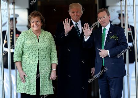 Stock Picture of President Donald Trump waves as he greets Irish Prime Minister Enda Kenny and his wife Fionnuala Kenny, left, on the South Lawn of the White House in Washington