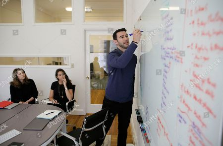 Founder Adam Braun, right, leads a meeting mapping out growth strategy at MissionU in San Francisco. MissionU, which began accepting its first applications last month, offers a one-year program in data analytics and business intelligence with an upfront tuition of $0. As part of a income-sharing agreement, MissionU students will be giving back 15 percent of their salary for three years after graduation, given that they make at least $50,000 per year