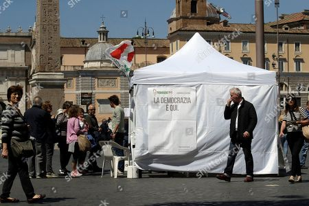 Citizens line up at a makeshift gazebo set up around the country for the Democratic party's primary elections, in Rome . Italians are voting for a new leader of the Democratic Party in a primary expected to give Matteo Renzi a fresh mandate. Challenging him in the primary are Justice Minister Andrea Orlando and Michele Emiliano, who is governor of the southern region of Puglia