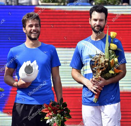 Winners Nikola Mektic of Croatia (L) and Brian Baker of USA (R) celebrate with their trophies after winning against Juan Sebastian Cabal and Robert Farah of Colombia in the double's final of Gazprom Hungarian Open tennis tournament in Budapest, Hungary, 30 April 2017.