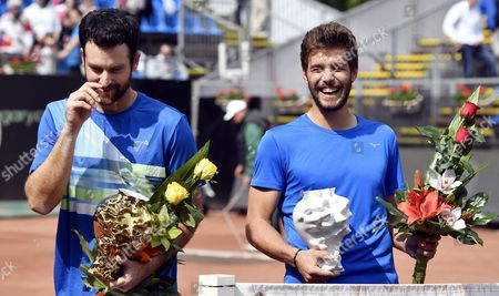 Winners Nikola Mektic of Croatia (R) and Brian Baker of USA (L) celebrate with their trophies after winning against Juan Sebastian Cabal and Robert Farah of Colombia in the double's final of Gazprom Hungarian Open tennis tournament in Budapest, Hungary, 30 April 2017.