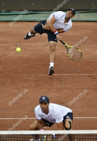 Juan Sebastian Cabal (above) and Robert Farah of Colombia in action against Nikola Mektic of Croatia and Brian Baker of USA in the double's final of Gazprom Hungarian Open tennis tournament in Budapest, Hungary, 30 April 2017.