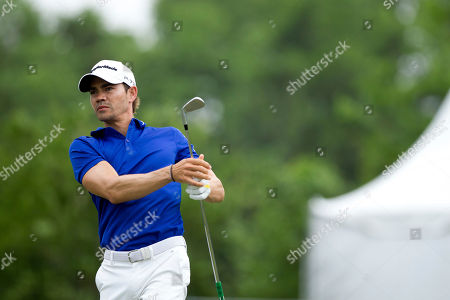 Camilo Villegas of Medelin, Columbia tees off on the third hole during the final round of the PGA Zurich Classic golf tournament's new two-man team format at TPC Louisiana in Avondale, La