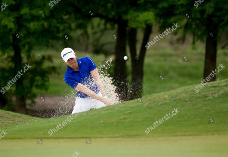 Camilo Villegas of Medelin, Columbia hits out of a sand trap on the second hole during the final round of the PGA Zurich Classic golf tournament's new two-man team format at TPC Louisiana in Avondale, La