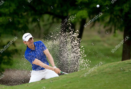 Camilo Villegas, of Medelin, Columbia, hits out of a sand trap on the second hole during the final round of the PGA Zurich Classic golf tournament's new two-man team format at TPC Louisiana in Avondale, La
