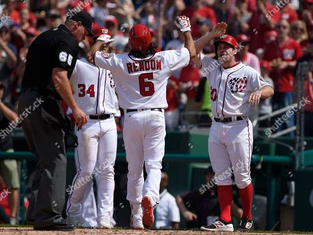 Anthony Rendon, Daniel Murphy, Bryce Harper Washington Nationals' Anthony Rendon (6) celebrates his three-run home run with Daniel Murphy, right, and Bryce Harper (34) during the fourth inning of a baseball game against the New York Mets, in Washington. Home plate umpire Ted Barrett (65) looks on