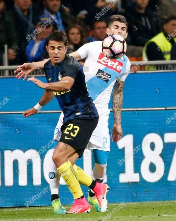 Inter Milan's Citadin Martins Eder, left, challenges for the ball with Napoli's Elseid Hysaj during the Serie A soccer match between Inter Milan and Napoli at the San Siro stadium in Milan, Italy