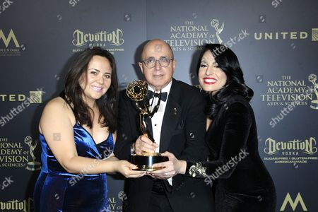 Stock Picture of Venezuelan journalist Alejandra Oraa (R), Cuban journalist Eduardo Suarez (C), and journalist Natalie Monterrosa, winners of the Emmy Award for Oustanding Entertainment Programm in Spanish pose in the press room of the 44th Daytime Emmy Awards at the Pasadena Civic Center in Pasadena, California, USA, 30 April 2017. The Daytime Emmy Awards recognize outstanding achievement in all fields of daytime television production.