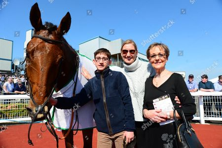 DOWN ROYAL. Trainer SANDRA HUGHES with son Philip and Mom Eileen, in the winners enclosure after ART OF PAYROLL won for them.