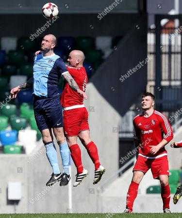 Enniskillen Rangers vs Hill Street. Enniskillen player manager Michael Kerr wins a header