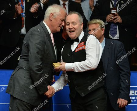 John Higgins of Scotland receives the runners up prize from Barry Hearn after the World Snooker Final match between John Higgins and Mark Selby played at the Crucible Theatre, Sheffield on Monday 1st May 2017