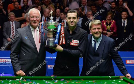 Mark Selby of England celebrates with Barry Hearn (left) after winning the World Snooker Final match between John Higgins and Mark Selby played at the Crucible Theatre