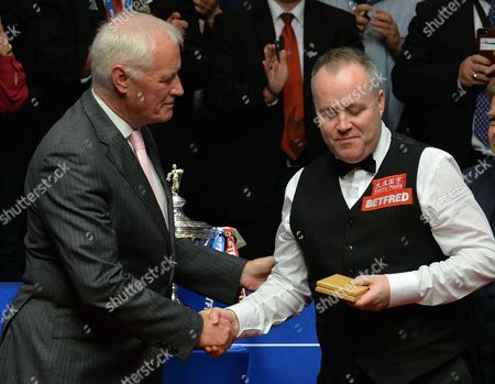 John Higgins of Scotland receives the runners up prize from Barry Hearn after the World Snooker Final match between John Higgins and Mark Selby played at the Crucible Theatre