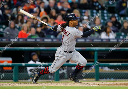 Cleveland Indians' Michael Martinez (1) singles against the Detroit Tigers in the fourth inning of a baseball game in Detroit