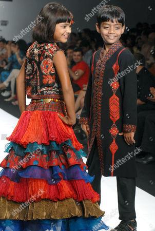 Rubina Ali Qureshi and Azharuddin Ismail walked the ramp for designers Ashima and Leena