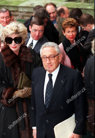 Henry Kissinger Former America Politician With His Wife Arriving At The St. Johns Church Smith Square This Morning For A Memorial Service For The Late Sir James Goldsmith.